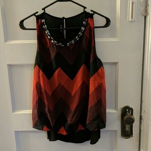 Red and black sleeveless blouse jeweled neckline
